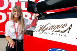 (September 26, 2008): Julie Catalano of Boise, Idaho, kneels next to her company's logo on the No. 99 Office Depot Ford driven by NASCAR star and current Sprint Cup Series point leader Carl Edwards