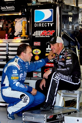 Ryan Newman, driver of the No. 12 alltel Dodge, talks to Clint Bowyer, driver of the No. 07 Jack Daniel's Chevrolet, in the garages of Kansas Speedway during Friday's practice. Both drivers will start in the middle of the pack on Sunday for the NASCAR Sprint Cup Series Camping World RV 400 (Newman at 15th and Bowyer at 24th). (Photo Credit: Matthew Stockman/Getty Images)