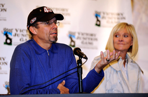 Driver Kyle Petty speaks to the media to announce the construction of a new Victory Junction camp while his wife Pattie looks on prior to practice for the NASCAR Sprint Cup Series Camping World RV 400 at Kansas Speedway. (Photo Credit: Rusty Jarrett/Getty Images for NASCAR)