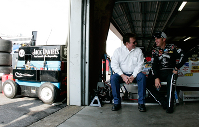 (Left to right) Richard Childress talks with his driver Clint Bowyer in the NASCAR Sprint Cup Series garage after Bowyer turned the fastest lap in Saturday's first practice at New Hampshire Motor Speedway. Bowyer will attempt to defend his Sylvania 300 title on Sunday at the track. (Photo Credit: Jason Smith/Getty Images for NASCAR)