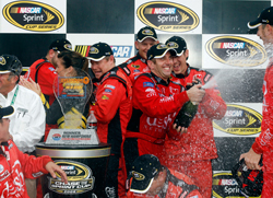 Greg Biffle and the No. 16 crew celebrate their first trip to Victory Lane this season and first win since Kansas last fall, taking the Sylvania 300 NASCAR Sprint Cup Series race at New Hampshire Motor Speedway on Sunday. (Photo Credit: Chris Trotman/Getty Images for NASCAR)