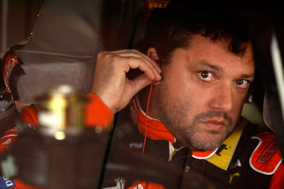 Tony Stewart straps into his ride for Saturday's first NASCAR Sprint Cup Series practice at New Hampshire Motor Speedway for the Sylvania 300, the first race in the Chase for the NASCAR Sprint Cup. Stewart was ninth-fastest in the practice. (Photo Credit: Jason Smith/Getty Images for NASCAR)
