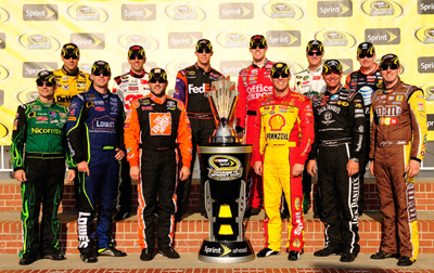 The 2008 Chase for the NASCAR Sprint Cup field poses with the Sprint Cup trophy after the Chevy Rock & Roll 400 at Richmond International Raceway. The drivers are (Back row L-R) Matt Kenseth, Greg Biffle, Denny Hamlin, Carl Edwards, Dale Earnhardt Jr., Jeff Burton (Front row L-R) Jeff Gordon, Jimmie Johnson, Tony Stewart, Kevin Harvick, Clint Bowyer and Kyle Busch. (Photo Credit: Rusty Jarrett/Getty Images for NASCAR)