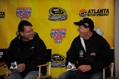 Johnny Benson and Ron Hornaday Jr. joked with each other at a news conference Friday at Atlanta Motor Speedway, but on the track, the two veteran drivers are battling for the NASCAR Craftsman Truck Series championship. (Photo Credit: Rusty Jarrett/Getty Images for NASCAR)