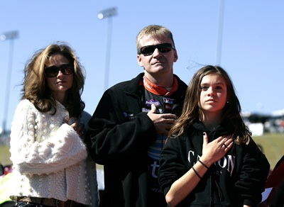 Jeff Burton, driver of the #31 AT&T Mobility Chevrolet, stands on the grid with wife Kim and daughter Paige, during the national anthem sung by
