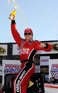Carl Edwards, driver of the No. 99 Office Depot Ford, celebrates his win of the NASCAR Sprint Cup Series Pep Boys Auto 500 in Victory Lane. (Photo Credit: Rusty Jarrett/Getty Images for NASCAR)