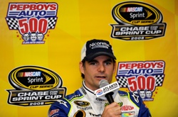 Jeff Gordon, driver of the No. 24 DuPont/Nicorette White Ice Mint Chevrolet, speaks with the media prior to practice for the NASCAR Sprint Cup Series Pep Boys Auto 500 at Atlanta Motor Speedway. (Photo Credit: Rusty Jarrett/Getty Images for NASCAR)