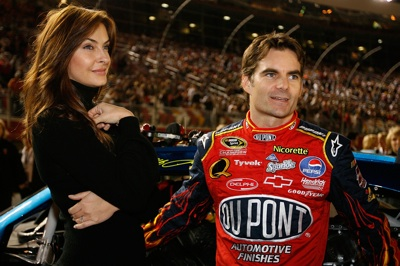 Wife Ingrid Vandebosch (L) and Jeff Gordon (R), driver of the #24 DuPont Chevrolet, wait by his car before the NASCAR Sprint Cup Series Bank of America 500 at Lowe's Motor Speedway on October 11, 2008 in Concord, North Carolina. (Photo by John Harrelson/Getty Images for NASCAR)