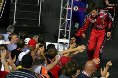 Kasey Kahne greets fans during pre-race introductions for the Bank of America 500 at Lowe's Motor Speedway. (Photo Credit: Todd Warshaw/Getty Images for NASCAR)