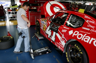 Reed Sorenson helps in the garage during NASCAR Sprint Cup Series testing at Lowe's Motor Speedway. Jeremy Mayfield tested the No. 41 Target Dodge normally driven by Sorenson. (Photo Credit: Streeter Lecka/Getty Images for NASCAR)