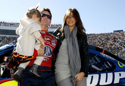 Jeff Gordon (C), driver of the #24 DuPont Chevrolet, stands on the grid with his wife Ingrid Vandebosch (R), and daughter Ella Sophia (L), prior to the start of the NASCAR Sprint Cup Series TUMS QuikPak 500 at Martinsville Speedway on October 19, 2008 in Martinsville, Virginia. (Photo by Jason Smith/Getty Images for NASCAR)