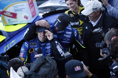 Crew chief Chad Knaus congratulates his driver Jimmie Johnson on winning the TUMS QuikPak 500 at Martinsvile Speedway on Sunday, October 19, 2008 (Courtesy Hendrick Motorsports)