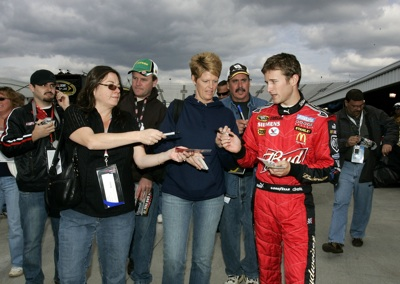 Kasey Kahne signs autographs for fans following the final practice for the TUMS QuikPak 500 at Martinsville Speedway. (Photo Credit: Jason Smith/Getty Images for NASCAR)