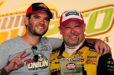 American Idol runner-up and recording artist Bo Bice celebrates with Todd Bodine, winner of the NASCAR Craftsman Truck Series Mountain Dew 250 fueled by Winn-Dixie at Talladega Superspeedway in Talladega, Ala. on Saturday. (Photo Credit: Rusty Jarrett/Getty Images for NASCAR)