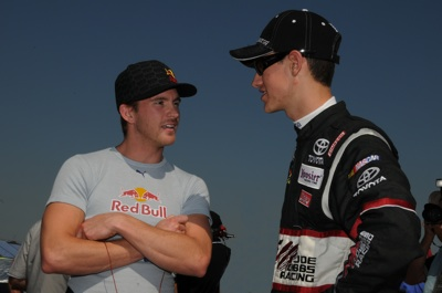 During NASCAR Craftsman Truck Series qualifying, (left to right) Scott Speed talks with Joey Logano, who will make his series debut in Saturday's race at Talladega Superspeedway in Talladega, Ala. (Photo Credit: Ronda Greer/NASCAR)