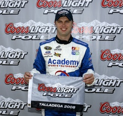 Travis Kvapil celebrates his first career NASCAR Sprint Cup Series pole on Saturday at Talladega Superspeedway in Talladega, Ala. He'll start first in Sunday's AMP Energy 500 after turning the fastest lap at 187.364 mph. (Photo Credit: Jason Smith/Getty Images for NASCAR)