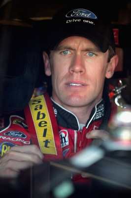 Sitting in second in the Chase for the NASCAR Sprint Cup, Carl Edwards straps into his car during NASCAR Sprint Cup Series practice Friday at Texas Motor Speedway. Edwards was third-fastest in practice and qualified 16th for Sunday's Dickies 500 at the track. (Photo Credit: Todd Warshaw/Getty Images for NASCAR)