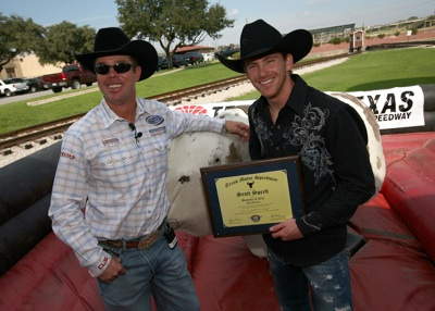 "Former four-time bull riding champion Tuff Hedeman (left) stands with NASCAR Sprint Cup Series driver Scott Speed (right) after he received his ""Bull Riding Diploma"" following his maiden ride on a mechanical bull in the Fort Worth Stockyards Tuesday, October 21, 2008. (Photo By Tom Pennington/Getty Images for the Texas Motor Speedway)"