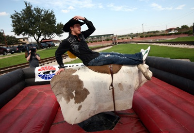NASCAR Sprint Cup Series driver Scott Speed takes a break -- and strikes a pose -- after his maiden ride on a mechanical bull in the Fort Worth Stockyards Tuesday, October 21, 2008.  (Photo By Tom Pennington/Getty Images for the Texas Motor Speedway)