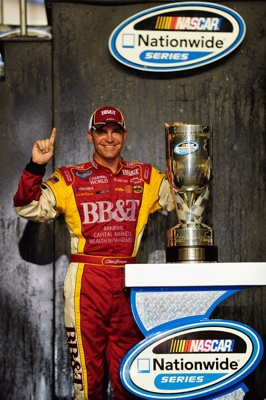 Clint Bowyer, driver of the #2 BB&T Chevrolet, poses after winning the 2008 NASCAR Nationwide Series Championship after the Ford 300 at Homestead-Miami Speedway on November 15, 2008 in Homestead, Florida (Getty Images for NASCAR)