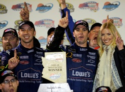 (L-R): Chad Knaus, Jimmie Johnson and Chandra Johnson celebrate their victory in the Checker O'Reilly Auto Parts 500 with the No. 48 team. (Photo Credit: Rusty Jarrett/Getty Images for NASCAR)