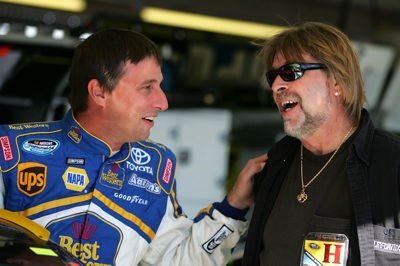 David Reutimann shares a laugh with Phil Harris of The Deadliest Catch. (Photo Credit: Todd Warshaw/Getty Images for NASCAR)