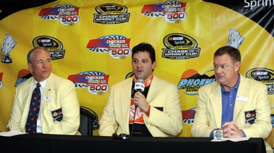 Tony Stewart (center) is introduced as the Grand Marshall of the upcoming Fiesta Bowl by Chairman of the Board Dave Tilson (left) and Executive Director John Junker (right). (Photo Credit: Rusty Jarrett/Getty Images for NASCAR)