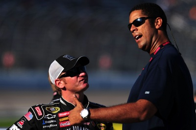 Clint Bowyer (L), driver of the #07 Jack Daniel's Chevrolet, talks with ESPN's Brad Daugherty (R) on the grid during qualifying for the NASCAR Sprint Cup Series Dickies 500 at Texas Motor Speedway on October 31, 2008 in Fort Worth, Texas. (Photo Credit: Robert Laberge/Getty Images for NASCAR)