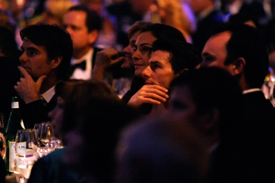 Actor Tom Cruise watches the NASCAR Sprint Cup Series Awards Ceremony while sitting at Jeff Gordon's table Friday night at the Waldorf=Astoria in New York City. (Photo Credit: Rusty Jarrett/Getty Images for NASCAR)