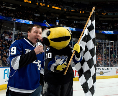 Defending Daytona 500 champion Ryan Newman starts the game between the Tampa Bay Lightning and the Philadelphia Flyers with Lightning mascot Thunderbug saying 'Let's Play Hockey' at the St. Pete Times Forum on January 15, 2009 in Tampa, Fla. (Photo Credit: Scott Audette/NHLI via Getty Images)