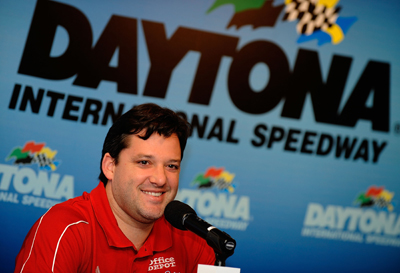 Tony Stewart chats with members of the media during the NASCAR Preseason Thunder Fanfest at Daytona International Speedway. (Photo Credit: Rusty Jarrett/Getty Images for NASCAR)