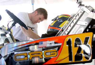 Jamie McMurray works on his kart at Daytona International Speedway during Daytona KartWeek By Cometic Gasket World Karting Association races. McMurray upgraded his pit area from last year with a new trailer that he purchased from fellow NASCAR competitor Jeff Burton. (Photo Credit: Motorsports Images & Archives)