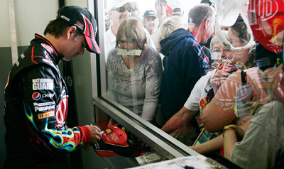 Three-time Daytona 500 winner Jeff Gordon signs autographs for fans during the final NASCAR Sprint Cup Series practice on Saturday for the Daytona 500 at Daytona International Speedway. (Photo Credit: Geoff Burke/Getty Images for NASCAR)