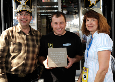 Steve and Christine Deuker meet NASCAR Sprint Cup Series driver Ryan Newman (center) on Saturday at Daytona International Speedway. The Deukers honored Newman and their son, who passed away in 2001, by buying a brick from the NASCAR Hall of Fame. (Photo Credit: Rusty Jarrett/Getty Images for NASCAR)