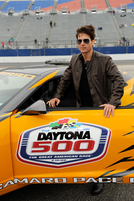 Tom Cruise climbs into the pace car for some practice laps around Daytona International Speedway. Cruise led the Daytona 500 to the green flag in the pace car. (Photo Credit: Rusty Jarrett/Getty Images for NASCAR)