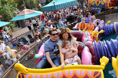 Four-time NASCAR Cup Series champion and three-time Daytona 500 winner Jeff Gordon (left) takes a spin with his wife Ingrid (right) and two-year-old daughter Ella (front right) February 9, 2009 on the Magic Carpets of Aladdin attraction at the Magic Kingdom in Lake Buena Vista, Fla. Gordon visited the Walt Disney World theme parks the week leading up to the 51st running of the Daytona 500. (Photo Credit: Garth Vaughan and Walt Disney World)