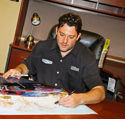 Tony Stewart signs autographs for fans at a local Office Depot store in Daytona Beach, Florida on February 10, 2009 (photo courtesy of Office Depot Racing)