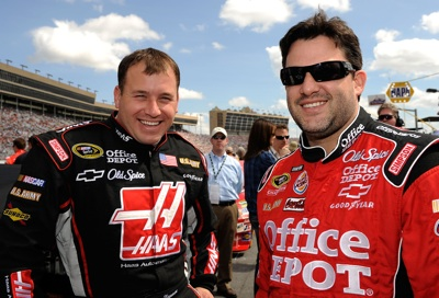 Ryan Newman, driver of the No. 39 Haas Automation Chevrolet shares a laugh with his car owner and driver of the No. 14 Office Depot/Old Spice Chevrolet, Tony Stewart, prior to Sunday's start of the NASCAR Sprint Cup Series Kobalt Tools 500 at the Atlanta Motor Speedway in Hampton, Ga. (Photo Credit: Rusty Jarrett/Getty Images for NASCAR)
