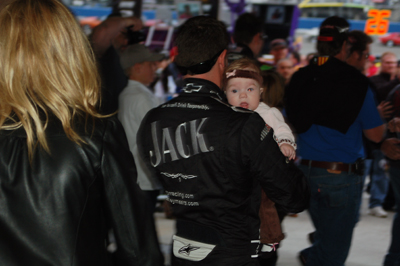 Casey Mears carries his daughter Samantha at the Auto Club Speedway on Sunday, February 22, 2009 (photo credit: Jameela Washington)