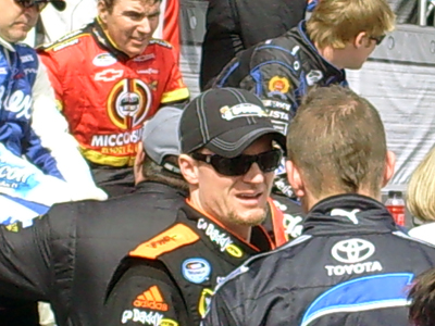 Dale Earnhardt Jr. and Scott Speed chat before driver introductions for the Sam's Town 300 at Las Vegas Motor Speedway on Saturday, February 28, 2009 (photo credit: The Fast and the Fabulous)