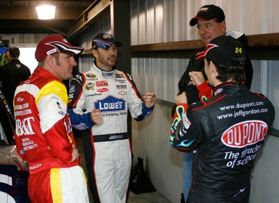(L-R): Clint Bowyer, Jimmie Johnson, Ron Hornaday Jr. and Jeff Gordon discuss their Martinsville driving styles while waiting for the rain to subside. (Photo Credit: Geoff Burke/Getty Images)