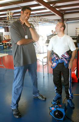 Marcos Ambrose (right), driver of the No. 47 Little Debbie/Kingsford/Clorox Toyota talks with team co-owner Brad Daugherty (left) during Friday's first practice for the NASCAR Sprint Cup Series Aaron's 499 at Talladega Superspeedway. (Photo Credit: Jerry Markland/Getty Images for NASCAR)