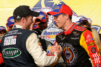 Dale Earnhardt Jr. (left), driver of the No. 88 National Guard/Amp Energy Chevrolet, congratulates Brad Keselowski (right), driver of the No. 09 Miccosukee Chevrolet, in Victory Lane on his first Sprint Cup Series win at the NASCAR Sprint Cup Series Aaron's 499 at Talladega Superspeedway. (Photo Credit: Rusty Jarrett/Getty Images for NASCAR)