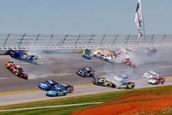 A multi-car incident involving 14 cars in Turn 4 brought out the first caution on lap 8 of Sunday's NASCAR Sprint Cup Series Aaron's 499 at Talladega Superspeedway. (Photo Credit: John Harrelson/Getty Images)