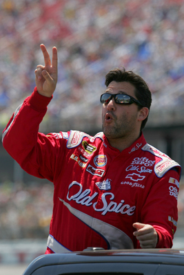 Tony Stewart, driver of the No. 14 Old Spice Chevrolet, waves to the fans following driver introductions and before the start of Sunday's NASCAR Sprint Cup Series Aaron's 499 at Talladega Superspeedway. (Photo Credit: Todd Warshaw/Getty Images)