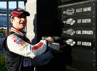 Jeff Gordon, driver of the #24 DuPont Chevrolet, adds his name to the Wall of Champions after winning the NASCAR Sprint Cup Series Samsung 500 at Texas Motor Speedway on April 5, 2009 in Fort Worth, Texas. (Photo by Jason Smith/Getty Images for Texas Motor Speedway)
