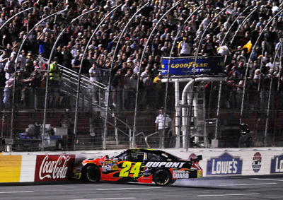 Jeff Gordon battled Kyle Busch and Ryan Newman three-wide during the 10-lap shootout before spinning and hitting the wall, ending his night eight laps short of the finish. (Photo Credit: John Harrelson/Getty Images)