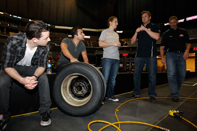 Everfine/Atlantic recording group O.A.R. learn how to perform a pit stop from the defending champions of the NASCAR Sprint Pit Crew Challenge Presented by Craftsman, the No. 83 Red Bull Racing Toyota team, on Wednesday at Time Warner Cable Arena in Charlotte, N.C. (Photo Credit: Streeter Lecka/Getty Images for NASCAR)