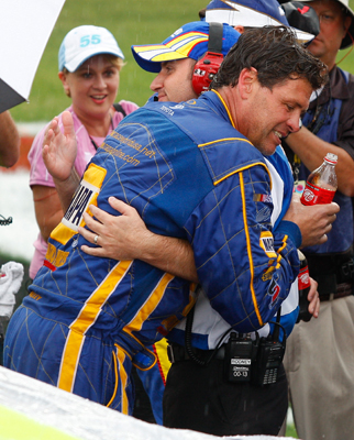 Team owner Michael Waltrip and winning crew chief Rodney Childers hug after the Coca-Cola 600 was called and Reutimann was declared the race winner. The win was the first in the NASCAR Sprint Cup Series for Michael Waltrip Racing. (Photo Credit: Geoff Burke/Getty Images for NASCAR)