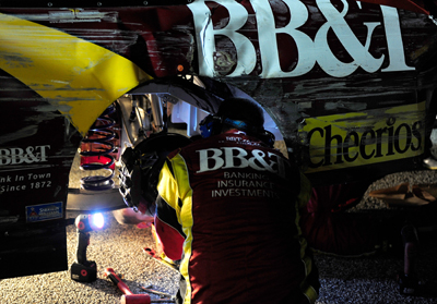 A No. 33 crew member works on the NASCAR Sprint Cup Series car after the 10th caution at lap 223 sent Clint Bowyer to the garage Saturday in the Southern 500 Presented by GoDaddy.com at Darlington Raceway. Bowyer's streak of consecutive starts without a DNF ended at 83, one shy of tying Herman Beam's nearly 50-year-old record. (Photo Credit: Rusty Jarrett/Getty Images for NASCAR)
